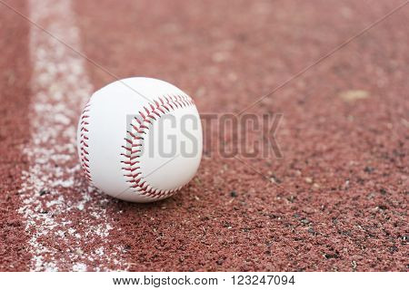 Baseball on the infield chalk line, close up