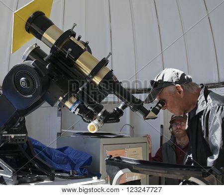 TUCSON, ARIZONA, FEBRUARY 28. Kitt Peak National Observatory on February 28, 2016, near Tucson, Arizona. A tourist looks at the sun at the solar viewing station at Kitt Peak National Observatory near Tucson Arizona.