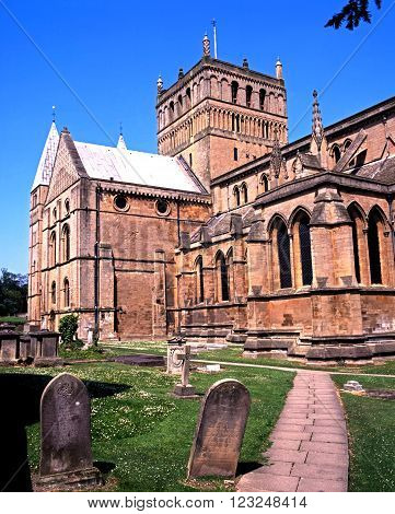SOUTHWELL, UNITED KINGDOM - MAY 16, 1992 - View of Southwell Minster with gravestones in the foreground Southwell Nottinghamshire England UK Western Europe, May 16, 1992.