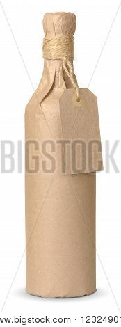 bottle of wine wrapped in kraft paper with a price tag isolated on white