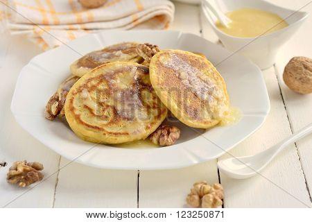 Corn flour pancakes with caramel syrup,  selective focus