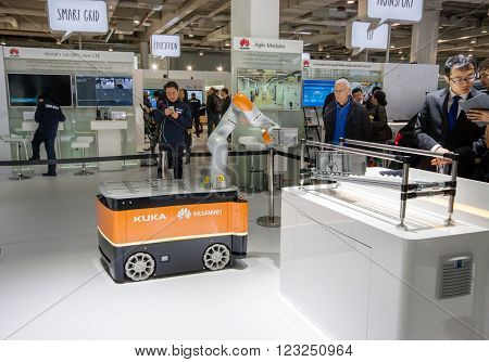 HANNOVER GERMANY - MARCH 15 2016: Industrial KUKA robot in booth of Huawei company at CeBIT information technology trade show in Hannover Germany on March 15 2016.
