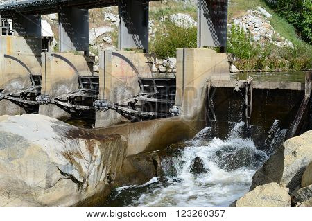 Radial gates control the water flow through this powerhouse situated deep within a Sierra Nevada canyon  on the Kern River, California.