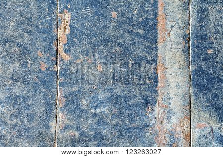 Background from old boards over the years, layers of paint, tinted in blue.
