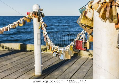 Chain of padlocks in love at the pier.