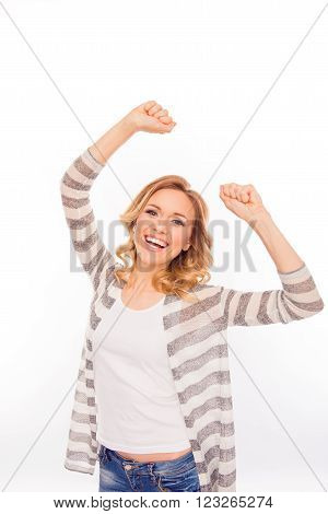 Portrait of happy young girl triumphing with raised fists