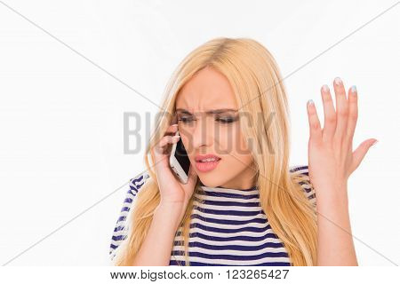 Portrait Of Surprised Young Woman Talking On Phone And Gesturing