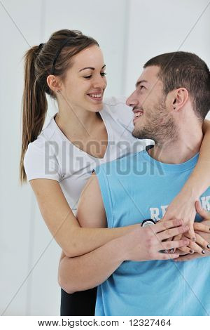 poster of happy young couple fitness workout and fun at sport gym club
