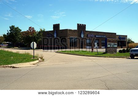 PLAINFIELD, ILLINOIS / UNITED STATES - SEPTEMBER 20, 2015: Merlin advertises a sale on shocks and struts in Plainfield.