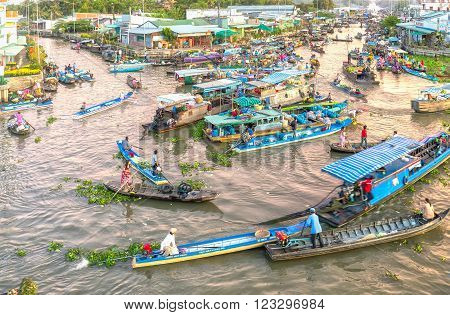Soc Trang, Vietnam - February 3rd, 2016: Scenes trade agricultural products in morning floating market with boatload full concentrated rotation rhythm intersection in filthy rivers characteristic wetland sale in Soc Trang, Vietnam