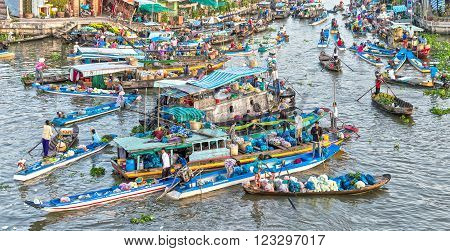 Soc Trang, Vietnam - February 3rd, 2016: Early Market on confluence with boatload agricultural between river gathered to sales, far away boat trip reverse sweep beautiful idyllic in Soc Trang, Vietnam