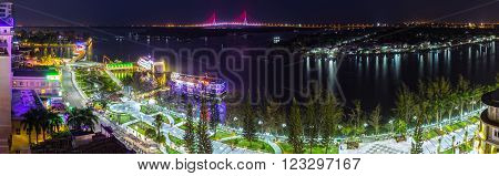 Can Tho, Vietnam - February 3rd, 2016: Panorama night city Can Tho Ninh Kieu wharf river with many sparkling lights, so far as Can Tho Bridge shines at night makes more lively night scene in Can Tho, Vietnam