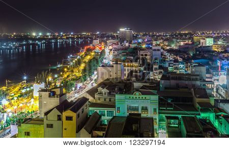 Can Tho, Vietnam - February 3rd, 2016: One corner Can Tho city in the night peace with houses along the river shining ornamental lights more beautiful and simple guide to make one miss away from home Can Tho, Vietnam