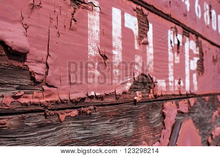 Detail view of a freight railway car with the word
