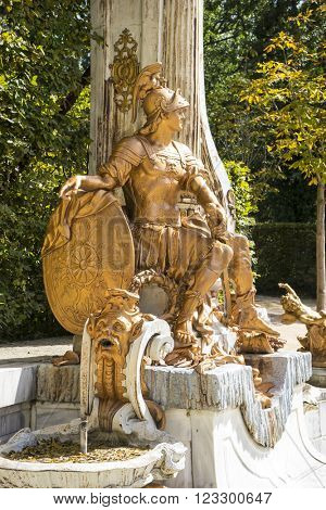 warrior, golden fountains in segovia palace in Spain. bronze figures of mythological gods and classic