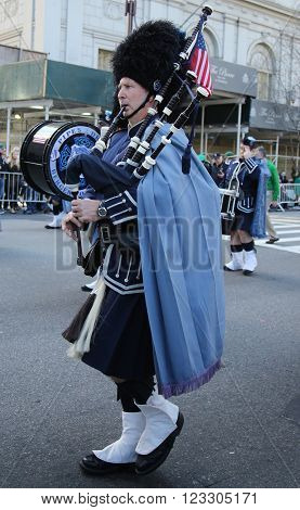 NEW YORK - MARCH 17, 2016: Bagpiper from Police Pipes and Drums of Bergen County marching at the St. Patrick's Day Parade in New York.
