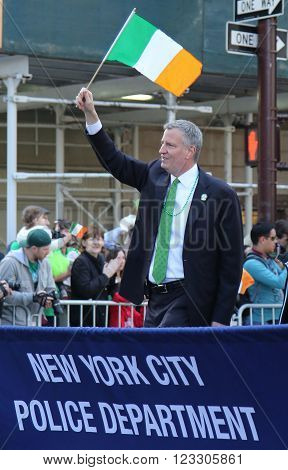 NEW YORK - MARCH 17, 2016: New York's mayor Bill De Blasio marching at the St. Patrick's Day Parade in New York.