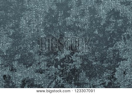 texture of textile fabric with spots from glossy scaly leather of dark indigo color for an abstract background or for the textured wallpaper