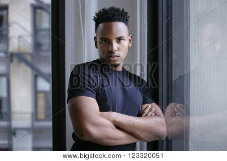 Portrait of a young afro american indoors with afro hairstyle
