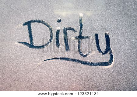 Dirty Text On A Grubby Dust Covered Window