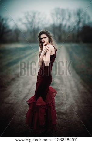 A beautiful sad girl in the autumnal field
