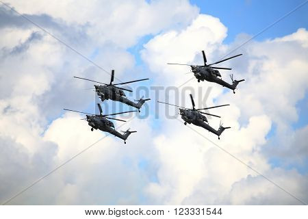RYAZAN REGION  - AUGUST 2: Four modern russian attack helicopters Mi 28 at a low altitude   -  on August 2, 2015 in Ryazan region