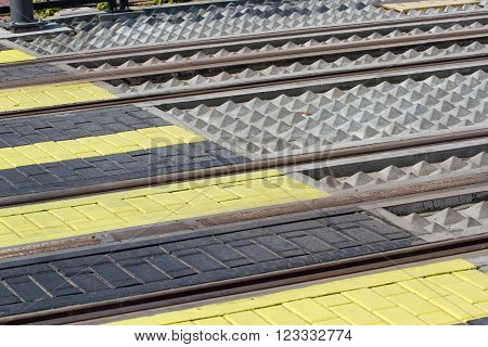 Modern crosswalk on tram track in Dubai, UAE