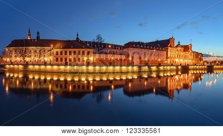 A cityscape of Wroclaw, view from river Odra, after sunset. Poland, Europe. Panorama.