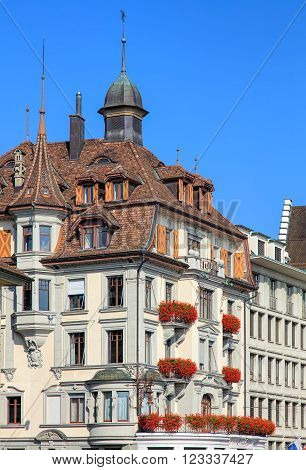 Lucerne, Switzerland - 3 October, 2015: upper part of the historic building Schwanenplatz square 2, housing Bank Julius Baer Lucerne office. Lucerne is the capital of the Swiss Canton of Lucerne.
