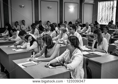 Kiev, Ukraine - July 6, 2015, National Medial University: dentists, doctors, students at lecture black and white