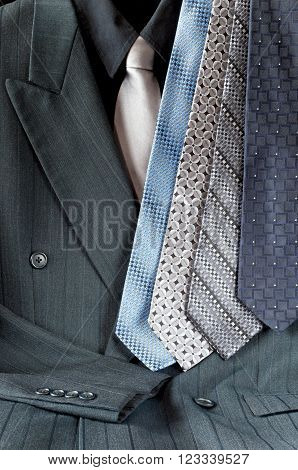 double-breasted pinstripe gray suit or mens sport jacket and shirt with assortment of neckties