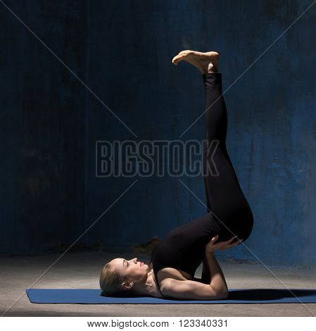 Beautiful Yoga Woman Doing Upside-down Seal Yoga Pose