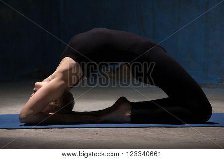 Beautiful Yoga Woman Doing Kapotasana Pose