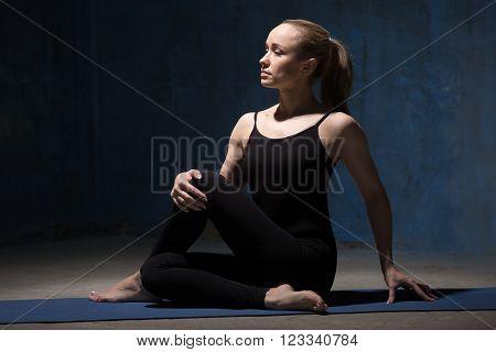 Beautiful Yoga Woman Doing Ardha Matsyendrasana Pose