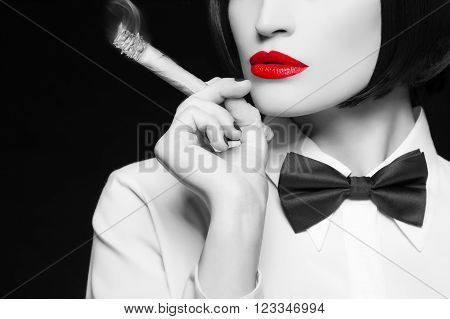 Mafia woman with cigar red lips selective coloring