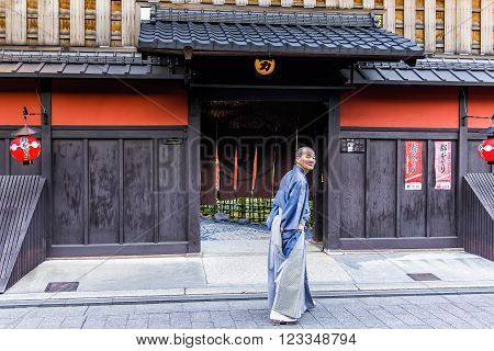Kyoto, Japan - April 23, 2014: Old man in front of Ichiriki Chaya entrance in Gion district. Ichiriki Chaya is one of the most famous and historic ochaya (geisha