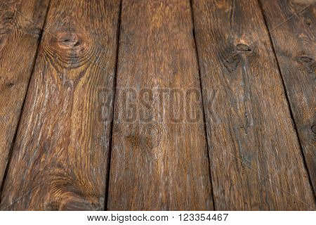 Wooden brown rustic texture. Rustic wood background. Looks like table or floor. Rustic brown wood. Horizontal picture. Rustic timber texture. Plank texture.