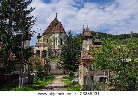 Biertan, Transylvania. Tourist Saxon Village With Fortified Church (castle) In Romania