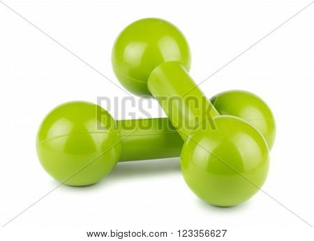 Pair of green dumbbells for fitness on white background
