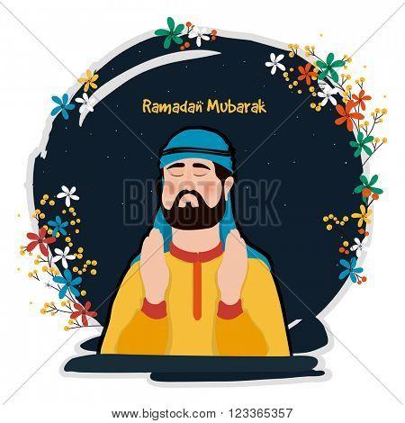 Young Arabian Man reading Namaz (Islamic Prayer) on colourful flowers decorated night background, Concept for Holy Month of Muslim Community, Ramadan Mubarak celebration.