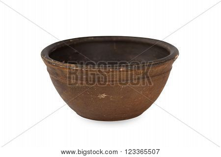 Old clay bowl on a white background.