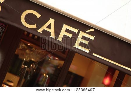 Coffee shop sign in Paris, dutch angle