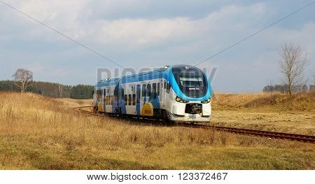 SLUTOWO, POLAND - March 19, 2016: The local train no. SA139-001 from Pila to Szczecin in Poland.