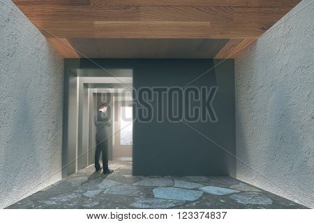 Office interior with concrete walls wooden ceiling and businessman watching the sunrise. 3D Render