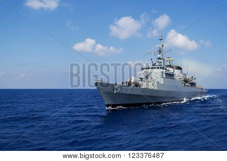 a big warship drives in mediterran sea