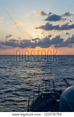 german navy cannon on sunset in the sea