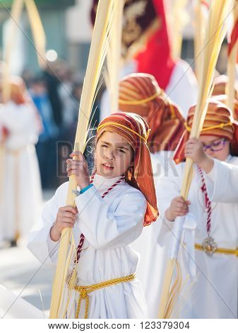 Algeciras Spain - 20 March 2016 unidentified children participate in Palm Sunday Procession Algeciras Spain. The palm leaves represent the arrival of Jesus Christ on Palm Sunday in Jerusalem