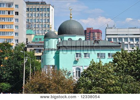 Moscow historic mosque on Prospect Mira, surrounded by green trees. poster