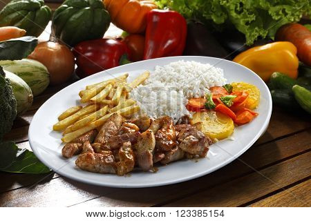 Rice with potatoes and meat.