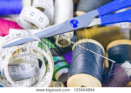 box of sewing thread,measuring tape and scissors